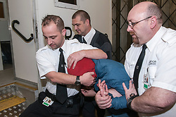 Prisoner being escorted to the transport in restraint, Southampton Crown Court