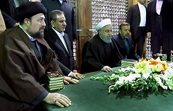 Iran's President Hassan Rowhani (2ndR), praying over the tomb of the founder of Iran's Islamic Republic Ayatollah Ruhollah Khomeini, at the latter's shrine in southern Tehran. Rouhani said that Iran must listen to protesters behind a recent wave of unrest, hinting that it risked another revolution if their demands were ignored. Photo by Parspix/ABACAPRESS.COM