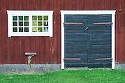 Traditional style Swedish wooden painted house. Black door. Window Barn Smaland region. Sweden, Europe.