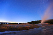 Stars come out above Old Faithful, Yellowstone National Park.