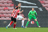 Southampton Josh Sims shoots with Manchester United Phil Jones trying to block during the Barclays U21 Premier League match between U21 Southampton and U21 Manchester United at the St Mary's Stadium, Southampton, England on 25 April 2016. Photo by Phil Duncan.