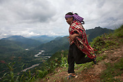 A young boy is running down the mountain side, returning to his village from a gathering.The Chepangs is an ethnic group which used to be nomadic. Only recently have the settled and their settlements are high up in the mountains.