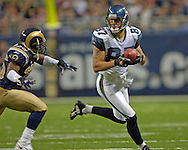 Seattle wide receiver Joe Jurevicius (87) picks up a first down after makeing a catch against St. Louis safety Mike Furrey (25) during the fourth quarter at the Edward Jones Dome in St. Louis, Missouri, October 9, 2005.  Seattle beat St. Louis 37-31.