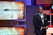 January 12, 2013- Washington, D.C- Actor Anthony Anderson host at the 2013 BET Honors held at the Warner Theater on January 12, 2013 in Washington, DC. BET Honors is a night celebrating distinguished African Americans performing at exceptional levels in the areas of music, literature, entertainment, media service and education. (Terrence Jennings)