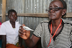 A young girl who is not feeling well is veighed, temperature checked  and admitted by Merceline Muga at teh ANC outreach Clinic. SAHFA baseline survey visit to Angiya, Homa Bay County, Kenya.  SAHFA Kenya © April 2019