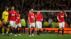 MANCHESTER, ENGLAND - Monday, April 30, 2012: Manchester United's players goalkeeper David de Gea, Chris Smalling, Patrice Evra,  Ryan Giggs, Wayne Rooney and Phil Jones look dejected after losing the Premiership match against Manchester City 1-0 at the City of Manchester Stadium. (Pic by David Rawcliffe/Propaganda)