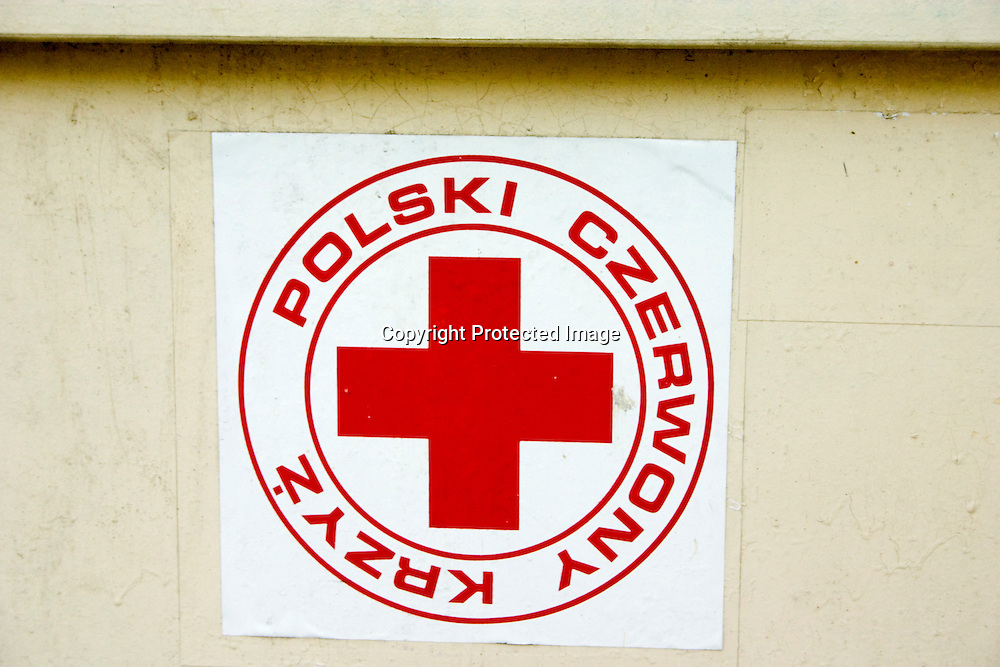 Red Cross symbol on clothing recycling bin. Balucki District Lodz Central Poland