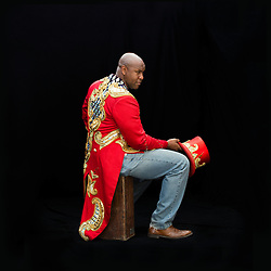 """Portrait of Ringmaster Johnathan Lee Iverson, who was born and raised in New York City. Iverson was Ringling Brother's first African American ringmaster. """"As the ringmaster of Ringling Brothers, you're the ambassador of the great American circus tradition. When you're speaking for Ringling Brothers, you're really speaking for the entire industry. What I love most [is that] it is possible to have extraordinary entertainment, high art, and appeal to anyone. Everybody loves the circus. [It's] a buffet of the extraordinary.""""<br /> <br /> """"I don't think people really know circus, and they don't really know circus people. They know, like, the myths and legends and romance of it, and you know, we're thought of as nomads and we're thought of as mysterious. And at one point that worked, you know, that sort of drew people in, but I think in this day and age, social media, where everybody knows everything it can kind of be strangely, it can work against your favor in the sense. So I think, now, we have this opportunity to really let people know who we are and what it takes to do what we do, inside our world. We humanize what we do, because if people don't know you they dehumanize you, whether for good or bad. They just dehumanize you, that's just what we do.""""<br /> <br /> """"Circus is the only craft I know of where people can actually use the very thing that people used to berate them with and become a star with that.""""<br /> <br /> After 146 years, the """"Greatest Show on Earth"""" will close its curtain in the end of May. <br /> Ringling Bros. and Barnum & Bailey Circus started in 1919 when the circus created by James Anthony Bailey and P. T. Barnum merged with the Ringling Brothers Circus. The circus' parent company, Feld Entertainment, made the decision to end the show after waning ticket sales and long court battles over the treatment of animals, particularly the elephants, made the costly entertainment event unsustainable."""