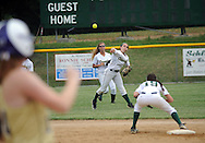 LYONS, PA - JUNE 09: Lansdale Catholic's shortstop Amanda Bradley tries to throw out a runner at first base during the PIAA Class AAA softball semifinal June 9, 2014 Lyons, Pennsylvania. (Photo by William Thomas Cain/Cain Images)