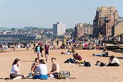 Portobello, Scotland, UK. 28 May, 2018. Sunny warm weather on a Bank Holiday Monday brought crowds to the beach at Portobello outside Edinburgh.