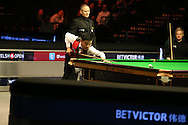 China's Ding Junhui pots the final black on his way to completing a 147 break during his match against Neil Robertson of Australia. Betvictor Welsh Open snooker 2016, day 5 at the Motorpoint Arena in Cardiff, South Wales on Friday 19th Feb 2016.  <br /> pic by Andrew Orchard, Andrew Orchard sports photography.