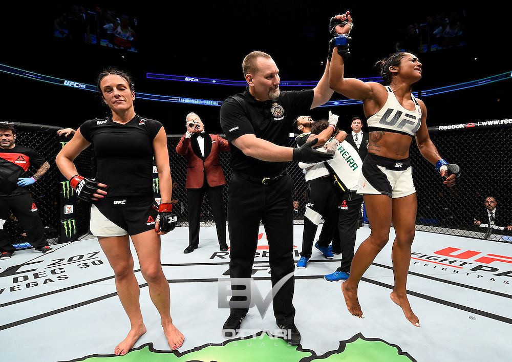TORONTO, CANADA - DECEMBER 10:  Viviane Pereira of Brazil celebrates after her split-decision victory over Valerie Letourneau of Canada in their women's strawweight bout during the UFC 206 event inside the Air Canada Centre on December 10, 2016 in Toronto, Ontario, Canada. (Photo by Jeff Bottari/Zuffa LLC/Zuffa LLC via Getty Images)