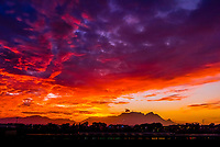 A blazing sunset, Table Mountain, Lion's Head Mountain and Signal Hill, Cape Town, South Africa.