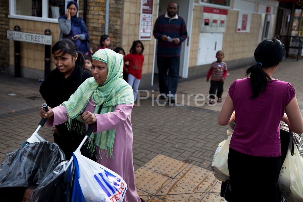 Multi cultural community along Roman Road in East London. The borough of Tower Hamlets has a population of 220,000, which includes one of the highest ethnic minority populations in the capital, consisting mainly of Bangladeshis.
