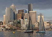 Two sailboats head for the finish line in the first Downtown Sailing Series of the season. (Greg Gilbert / The Seattle Times)