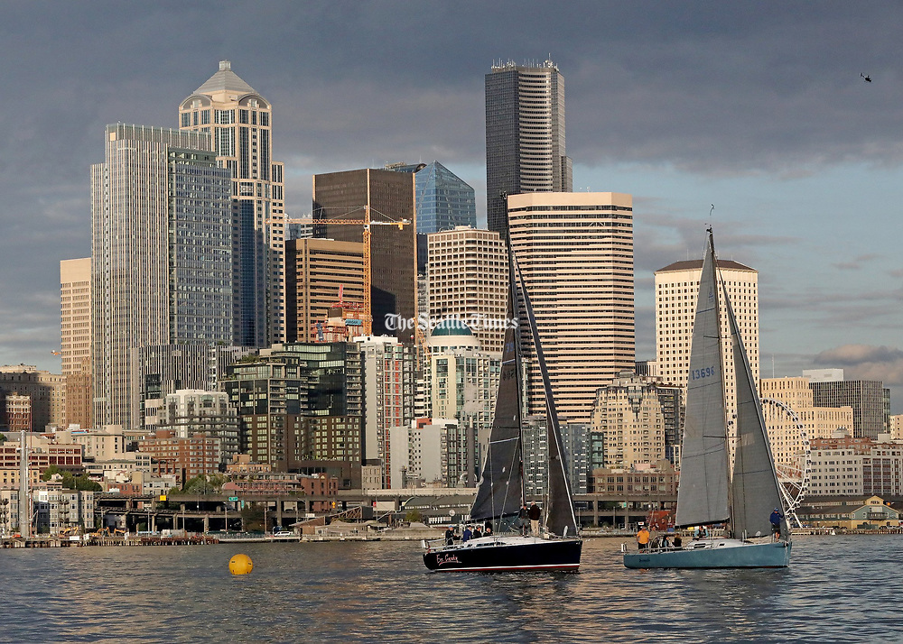 Two sailboats race for the finish line. (Greg Gilbert / The Seattle Times)