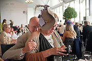 PHIL DOBSON; BRIGITTE STEPPUTTIS, Fashion shows in the Besborough Restaurant during Ascot week. Ascot. Tuesday 16 June 2009.