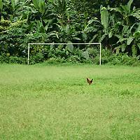 """Football field with an """"alternative"""" usage at the roça Agostinho Neto."""