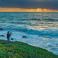 A photographer shoots a sunset at at Point Montara, California.