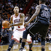 29 January 2012: Chicago Bulls point guard Derrick Rose (1) looks to pass over Miami Heat point guard Norris Cole (30) during the Miami Heat 97-93 victory over the Chicago Bulls at the AmericanAirlines Arena, Miami, Florida, USA.