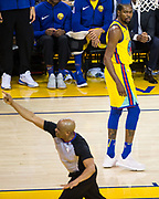 Referee Tre Maddox (73) ejects Golden State Warriors forward Kevin Durant (35) during a NBA game against the Milwaukee Bucks at Oracle Arena in Oakland, Calif., on March 29, 2018. (Stan Olszewski/Special to S.F. Examiner)
