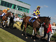 Jockey John Egan on Just Marion in the Parade Ring before the 4.20 race at Brighton Racecourse, Brighton & Hove, United Kingdom on 10 June 2015. Photo by Bennett Dean.