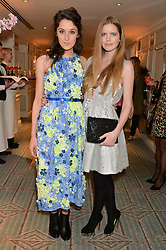 Left to right, ROSANNA FALCONER and KATIE READMAN at the launch of Mrs Alice in Her Palace - a fashion retail website, held at Fortnum & Mason, Piccadilly, London on 27th March 2014.