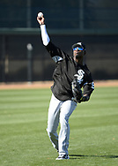 GLENDALE, ARIZONA - FEBRUARY 22:  Luis Robert #92 of the Chicago White Sox throws the baseball during a during spring training workout February 22, 2018 at Camelback Ranch in Glendale Arizona.  (Photo by Ron Vesely)  Subject:   Luis Robert
