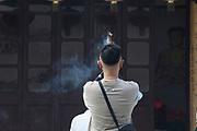 Man praying at the Jade Buddha Temple  in Shanghai. Asia, china.