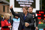 Gareth Ainsworth, the Wycombe Wanderers manager gives a thumbs up to the Wycombe supporters as he enters the dugout before k/o. Skybet football league two match, Wycombe Wanderers v Hartlepool Utd at Adams Park in High Wycombe, Bucks on Saturday 5th Sept 2015.<br /> pic by John Patrick Fletcher, Andrew Orchard sports photography.