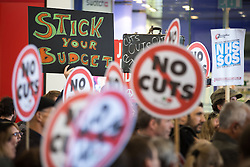 © Licensed to London News Pictures . 08/07/2015 . Manchester , UK . Approximately 100 people at a demonstration against today's (8th July 2015) budget , organised by the People's Assembly , in Manchester City Centre . Photo credit: Joel Goodman/LNP