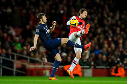 Man Utd Midfielder Michael Carrick (ENG) and Arsenal Midfielder Tomas Rosicky (CZE) compete for the ball - Photo mandatory by-line: Rogan Thomson/JMP - 07966 386802 - 12/02/14 - SPORT - FOOTBALL - Emirates Stadium, London - Arsenal v Manchester United - Barclays Premier League.