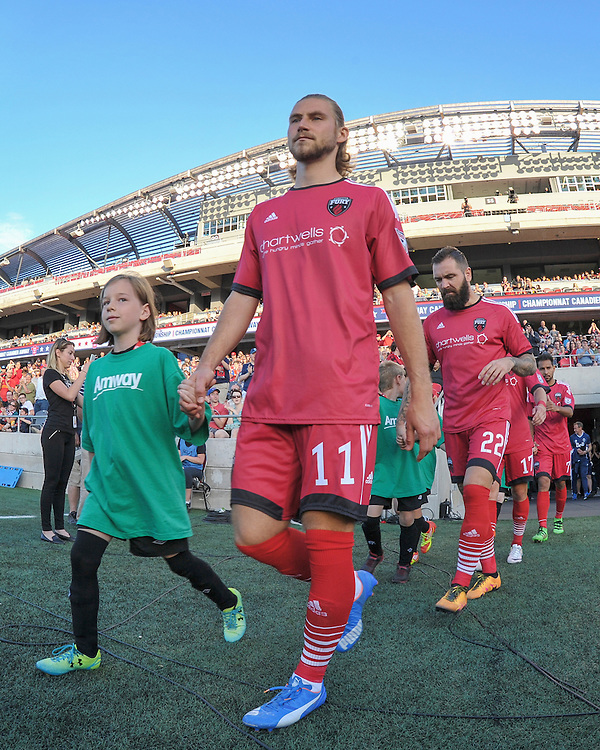 Ottawa Fury FC midfielder Mozzi Gyorio (#11) walks out onto the field for the Amway Canadian Championship semi-final first leg match between the Ottawa Fury FC and the Vancouver Whitecaps at TD Place Stadium in Ottawa, ON. Canada on June 1, 2016.<br /> <br /> PHOTO: Steve Kingsman/Freestyle Photography