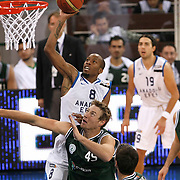 Anadolu Efes's Terence KINSEY (B) and Aliaga Petkim's Paul Andrew MILLER (F) during their Turkish Basketball League match Anadolu Efes between Aliaga Petkim at Aliaga Arena in Istanbul, Turkey, Sunday, October 23, 2011. Photo by TURKPIX