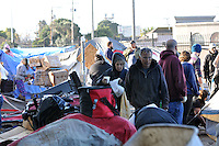 A scene of confusion and abject misery on Monday morning in Salinas' Chinatown, as private contractors hired by the city of Salinas clear out the possessions of homeless people residing on the property of 38 Soledad St.