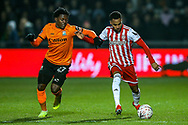 Barnet midfielder Ephron Mason-Clark (27) tussles with Brentford defender Rico Henry (3) during the The FA Cup fourth round match between Barnet and Brentford at The Hive Stadium, London, England on 28 January 2019.