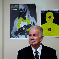 GAINESVILLE, FL -- August 18, 2010 -- Pastor Terry Jones poses for a portrait in his office under bullet ridden targets at the Dove World Outreach Center in Gainesville, Fla., on Wednesday, August 18, 2010.  The church is planning on burning multiple copies of the Koran on the anniversary of the September 11th terrorist attacks.  (Chip Litherland for The New York Times)