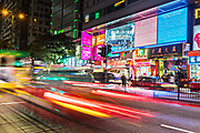 Traffic streaks down Nathan Road past ChungKing Mansions in Tsim Sha Tsui, Kowloon, Hong Kong.
