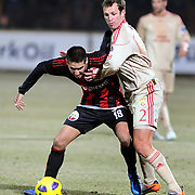 Gaziantepspor's Ismael SOSA (L) and Galatasaray's Lucas NEILL (R) during their Turkish superleague soccer match Gaziantepspor between Galatasaray at the Kamil Ocak stadium in Gaziantep Turkey on Saturday 12 February 2011. Photo by TURKPIX