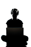 one caucasian young teenager silhouette boy or girl computer computing laptop full length in studio cut out isolated on white background