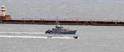 © Licensed to London News Pictures. 26/10/2021. DOVER, UK. Migrants arriving at Dover docks again today whilst weather conditions are still bad.  The sea is rough as the weather changes for winter. Border Force boats Hunter, Hurricane & Vigilant are out picking up dinghies. Photo credit: Stuart Brock/LNP