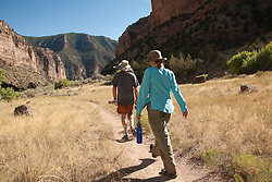 North America, United States, Colorado, Dinosaur National Monument, Green River (Gates of Lodore section), couple hiking in canyon.  MR