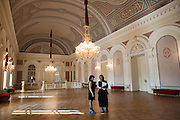 Moscow, Russia, 08/10/2011..Staff inside the Bolshoi Theatre wear proective coverings over their shoes during a press tour showcasing the almost completed renovation work. The building has been closed for repairs since 2005 and is scheduled to reopen on October 28th 2011.