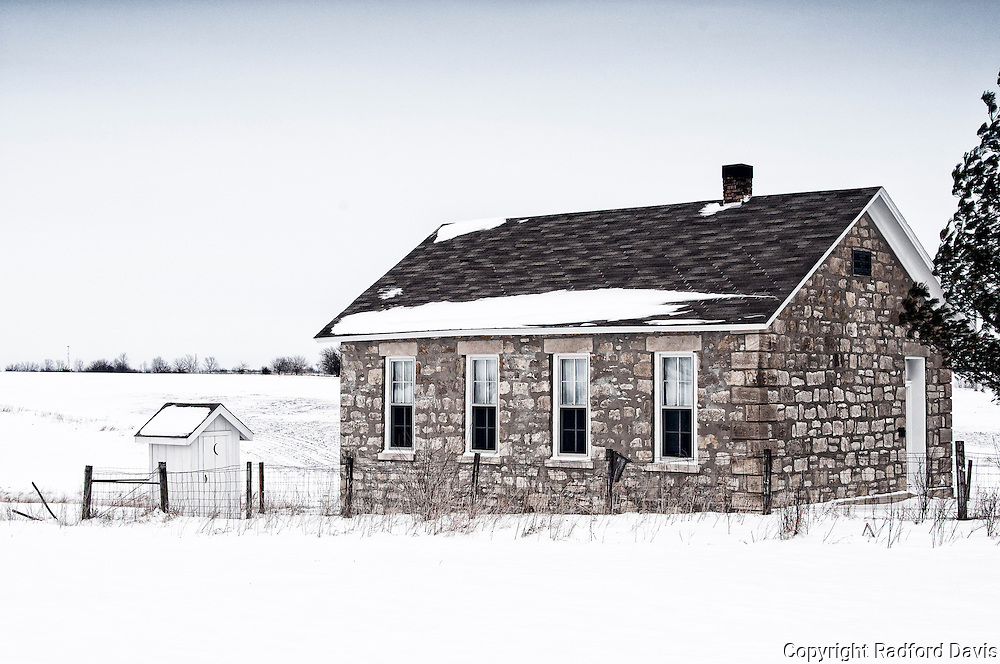 Winter school house and outhouse, Iowa