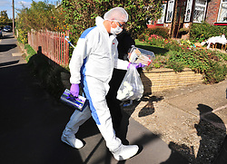 © Licensed to London News Pictures. 29/09/2018<br /> HADLOW, UK.<br /> Police forensics officer walking to property.<br /> A murder investigation has been launched in Hadlow,Kent after the deaths of two women at Carpenters Lane. A 28 year old man has been arrested on suspicion of murder after three people suffered serious injuries. Police forensic officers are at the scene inside two properties 26 and 24 Carpenters Lane.<br /> Photo credit: Grant Falvey/LNP