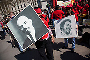Lenin and Che Guevara posters. Demonstration by unions and other organisations of workers to mark the annual May Day or Labour Day. Groups from all nationalities from around the World, living in London gathered to march to a rally in central London, UK.