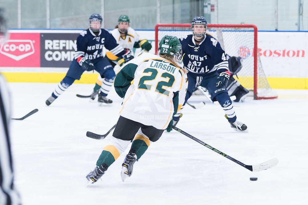 5th year defender Alexis Larson (22) of the Regina Cougars in action during the Women's Hockey home game on October 8 at Co-operators arena. Credit: Arthur Ward/Arthur Images
