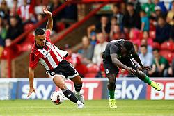 Nico Yennaris of Brentford intercepts the ball from Mame Biram Diouf of Stoke City - Mandatory by-line: Jason Brown/JMP - Mobile 07966 386802 25/07/2015 - SPORT - FOOTBALL - Brentford, Griffin Park - Brentford v Stoke City - Pre-Season Friendly