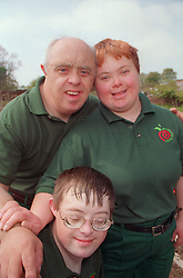 Portrait of a group of adults with Downs Syndrome working on community allotment project,