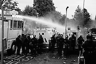 Riot breaks out on Woodvale Road, in Belfast, as Orange order march is prevented from passing through the largely Catholic Ardoyne area.